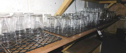 Glassware to shelf behind bar
