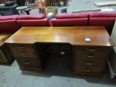 A large wooden twin pedestal desk