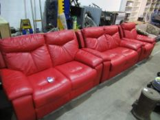 A red leather effect three piece reclining suite