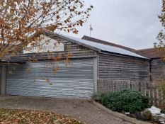 Celsa Galvanised Portal Framed Shed with Galvanised Manual Roller Shutter Door.