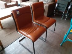 Pair of Nancy tubular steel chairs, brown vinyl