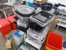 Large quantity of assorted plastic serving trays with lids, etc