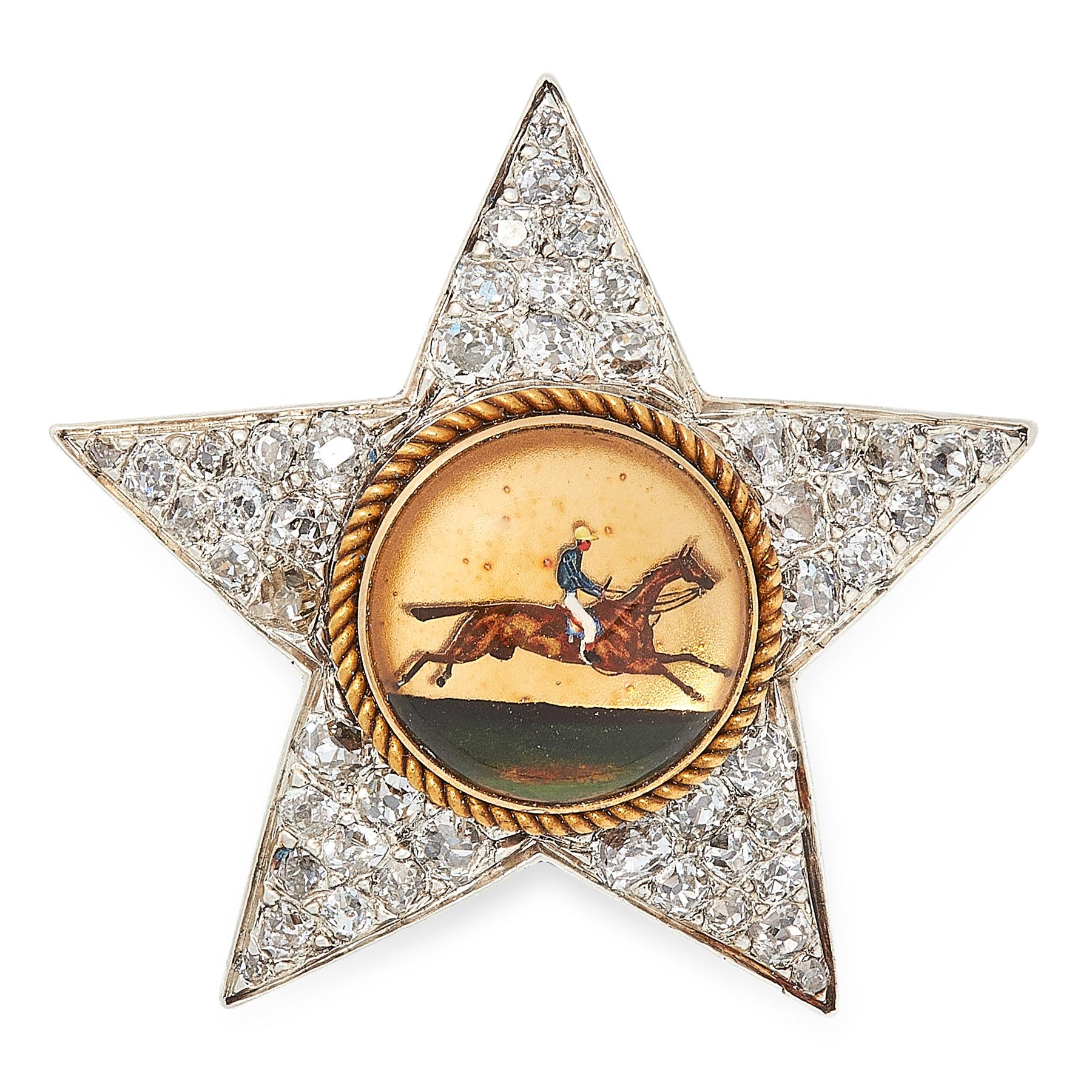 Lot 5 - AN ANTIQUE REVERSE CARVED INTAGLIO AND DIAMOND BROOCH in yellow gold and silver, designed as a star,