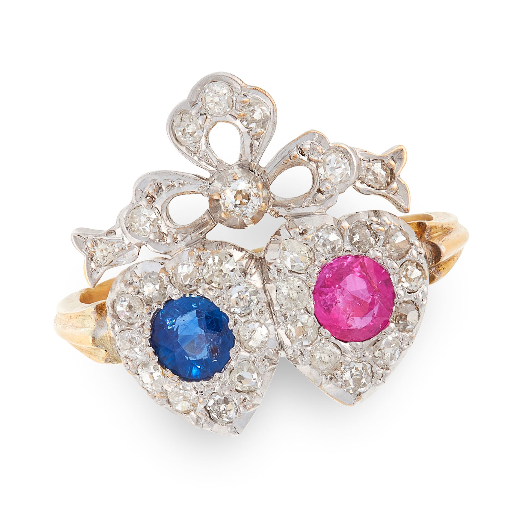 A SAPPHIRE, RUBY AND DIAMOND SWEETHEART RING in 18ct yellow gold and silver, in ribbon and heart