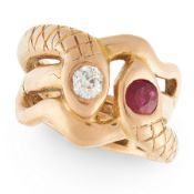 AN ANTIQUE RUBY AND DIAMOND SNAKE RING in 18ct yellow gold, designed as two intertwined snakes,