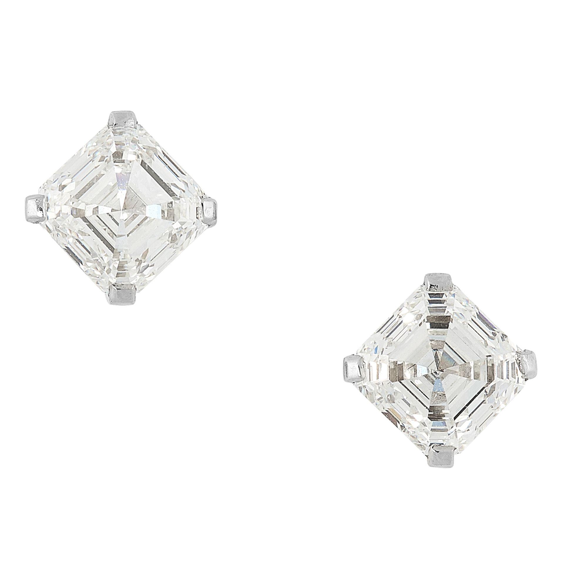 A PAIR OF 4.03 CARAT DIAMOND STUD EARRINGS each set with an asscher cut diamond of 2.02 and 2.01