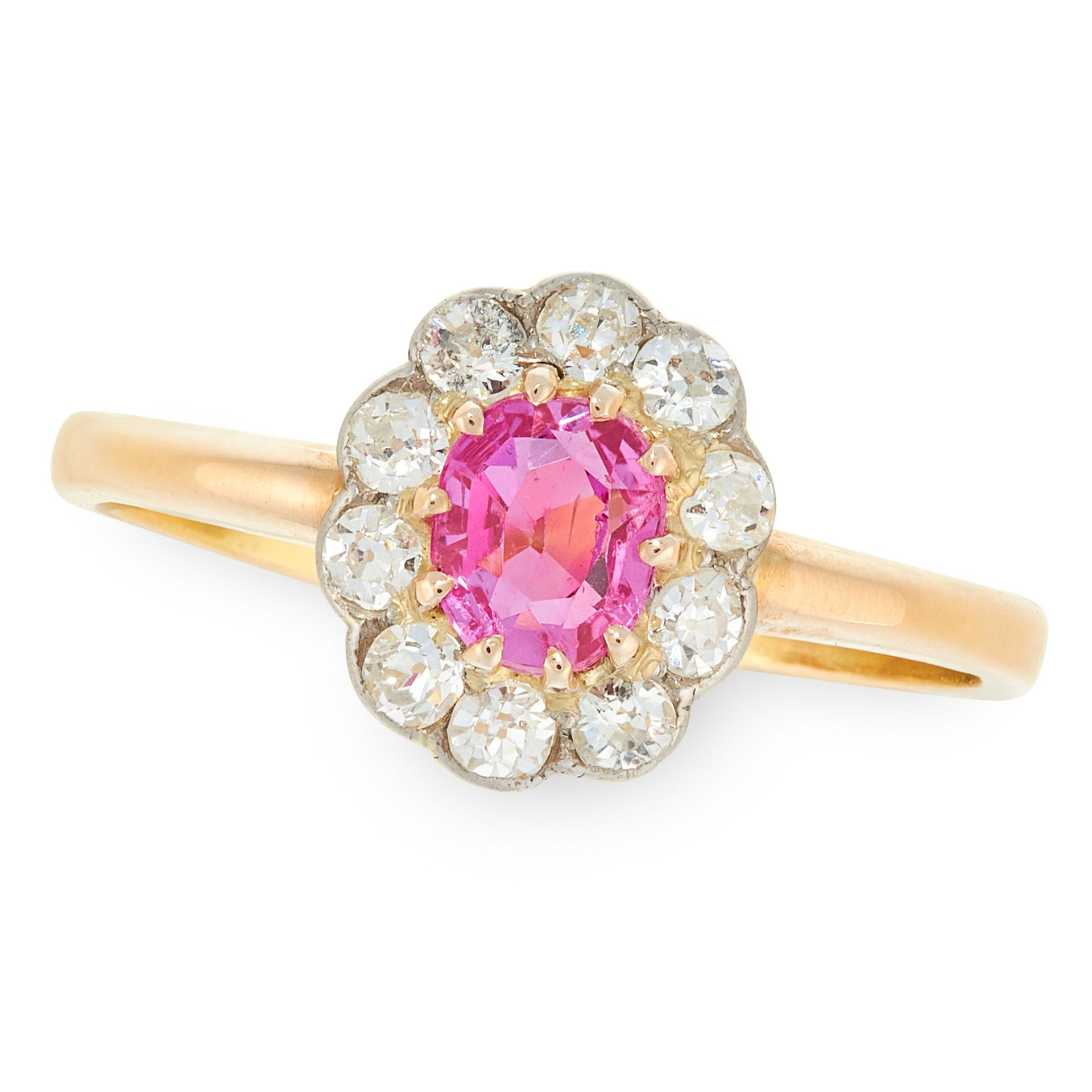 A RUBY AND DIAMOND CLUSTER in 18ct yellow gold and platinum, set with a oval cut ruby of 0.65 carats
