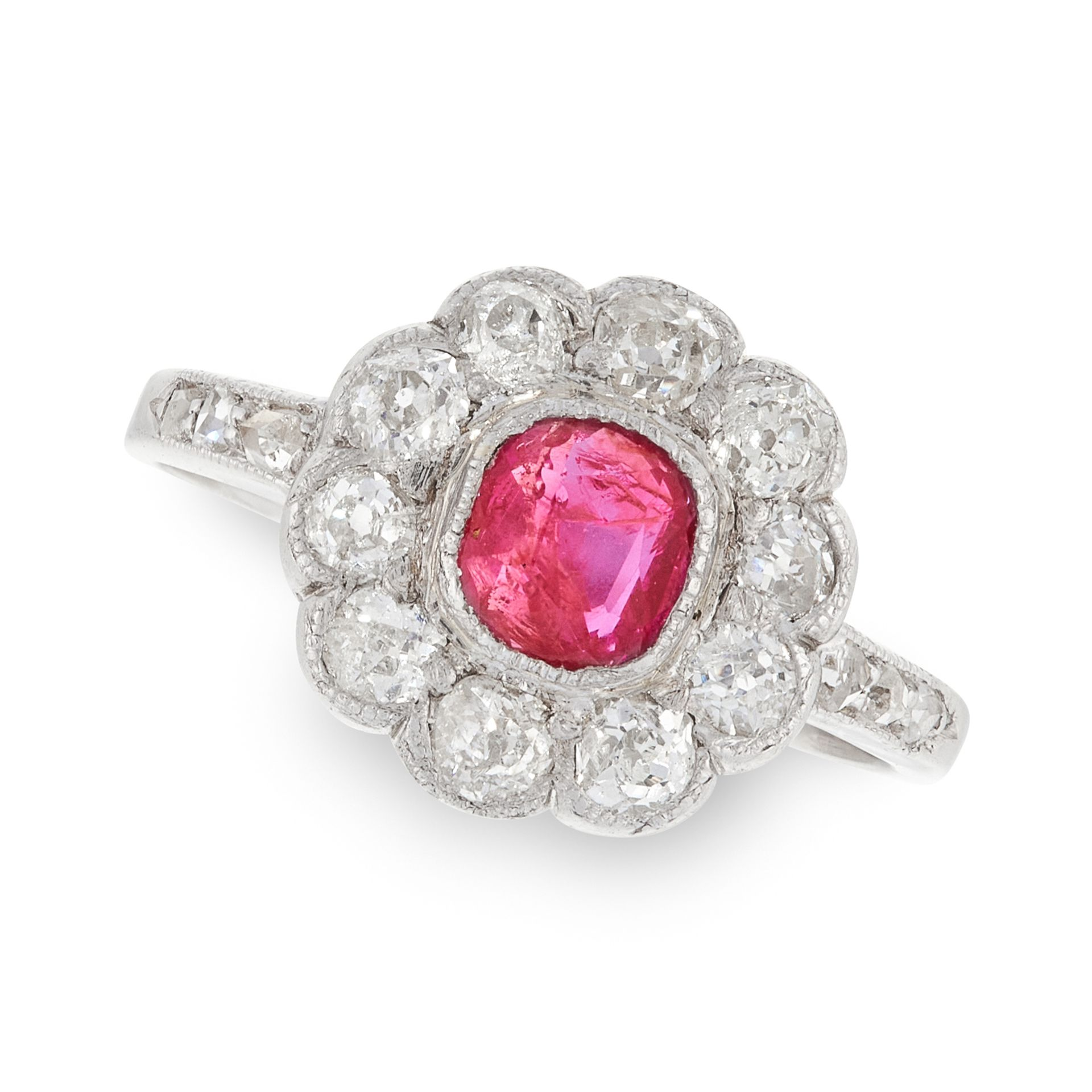 A RUBY AND DIAMOND CLUSTER RING in white gold or platinum, set with a cushion cut ruby of 0.55