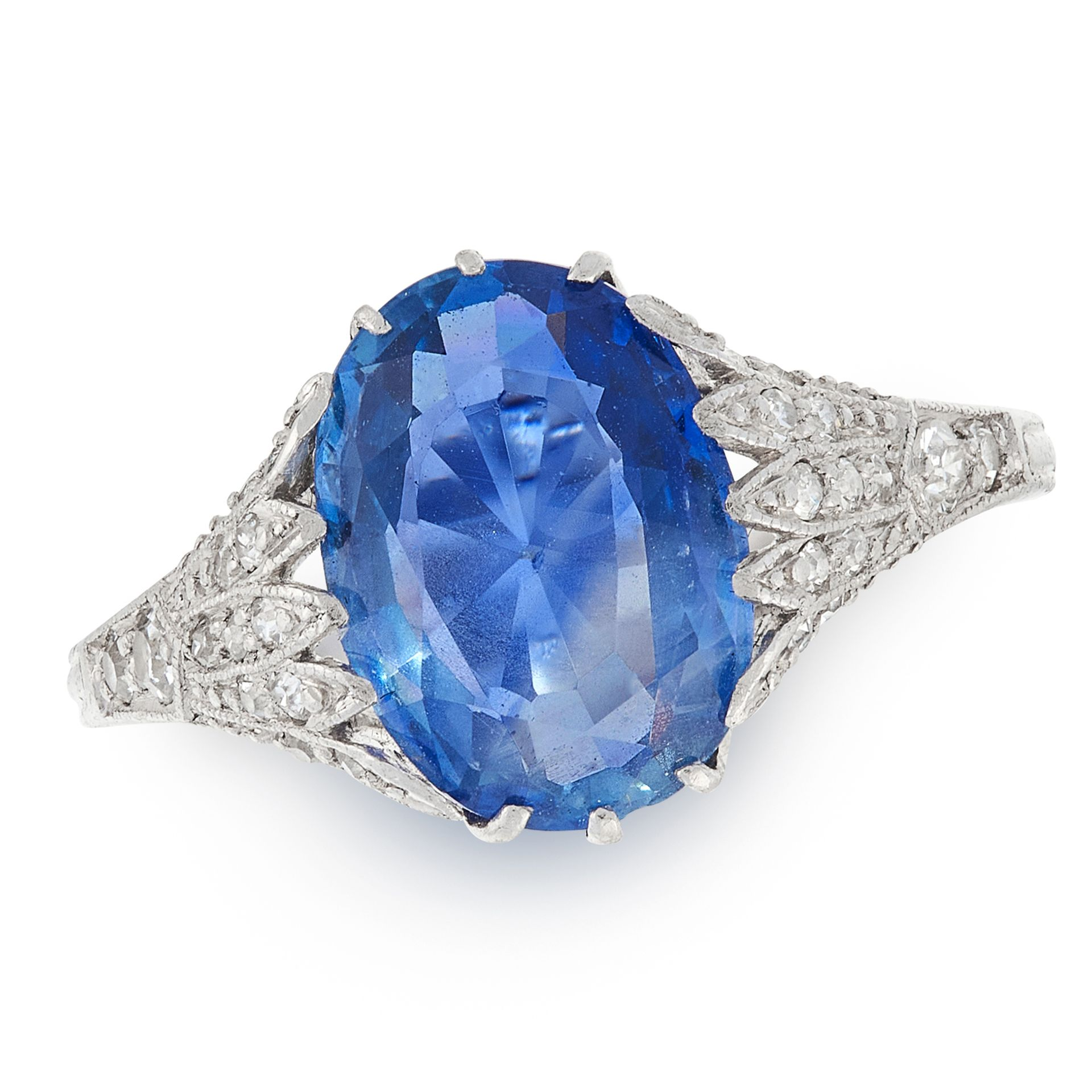 A SAPPHIRE AND DIAMOND DRESS RING in platinum, set with an oval cut sapphire of 3.51 carats accented