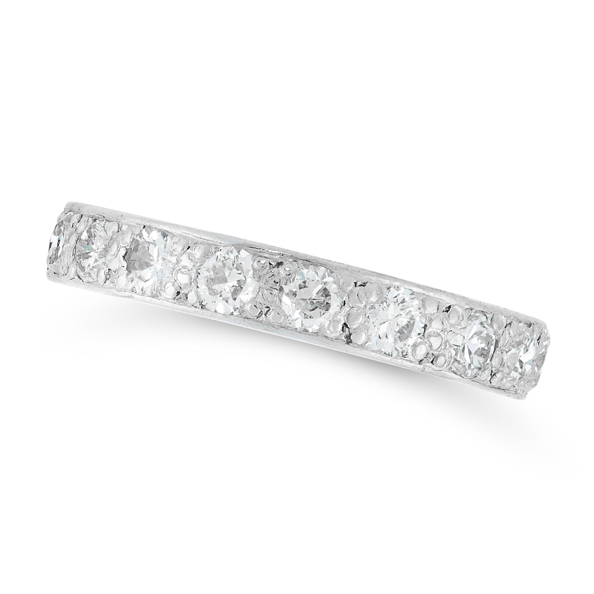 A DIAMOND ETERNITY RING in platinum, designed as a band set with a single row of round cut