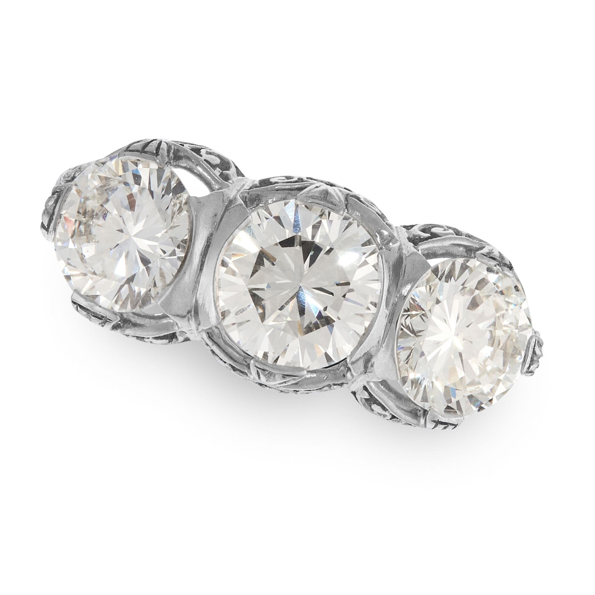 A DIAMOND THREE STONE RING set with a trio of round cut diamonds, the largest of 1.01 carats,