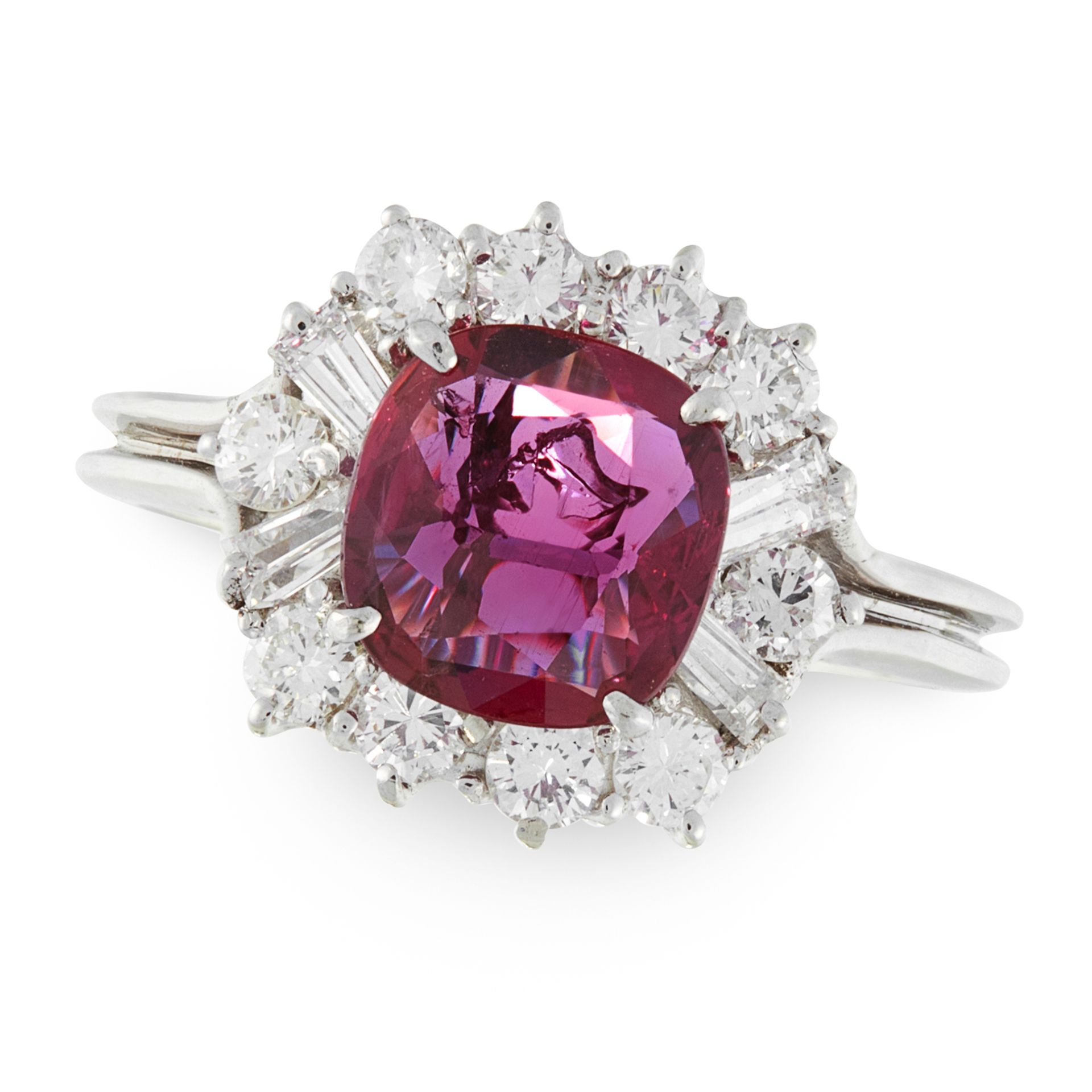 A RUBY AND DIAMOND CLUSTER RING in 18ct white gold, set with a cushion cut ruby of 1.22 carats