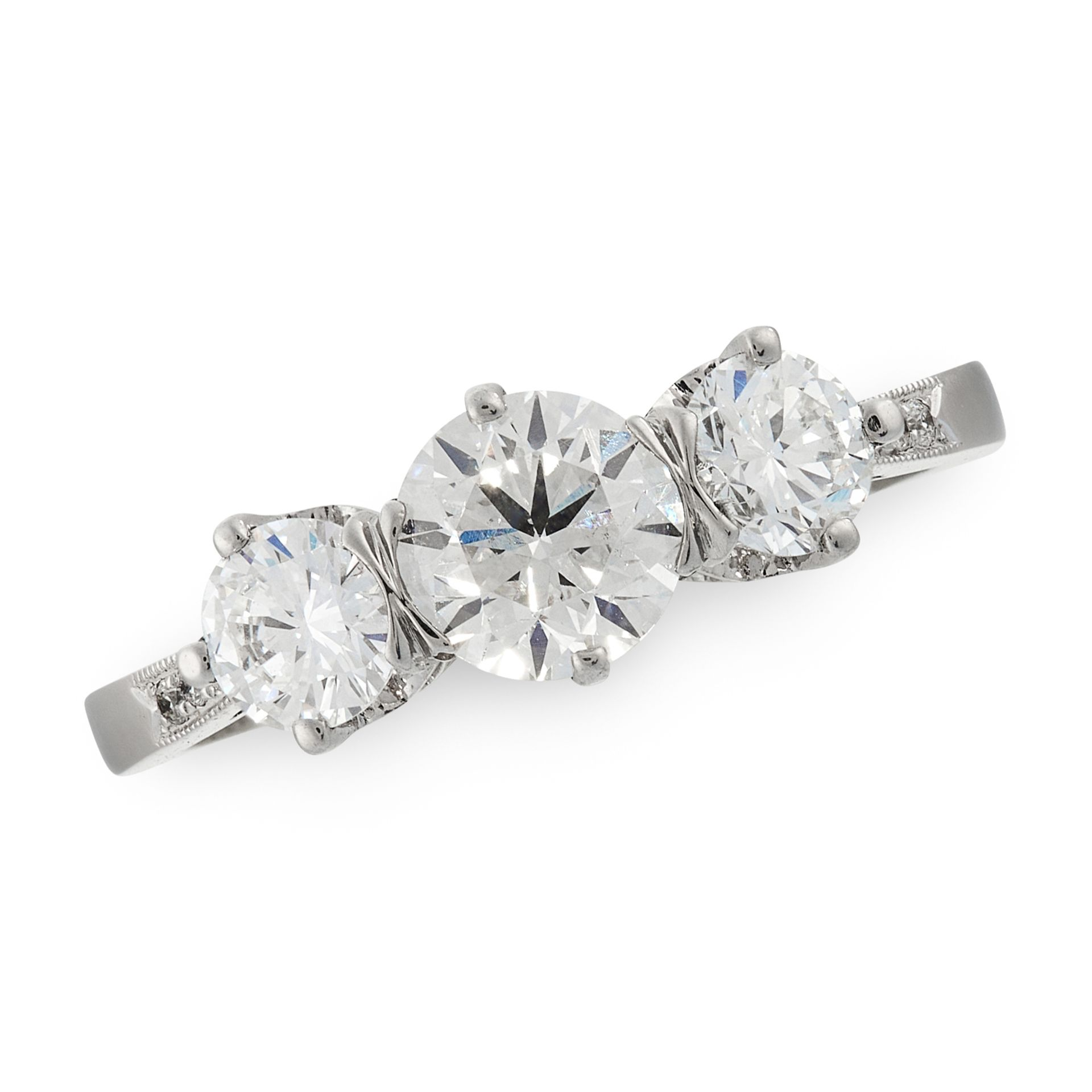 A DIAMOND THREE STONE RING in platinum, set with a trio of graduated round cut diamonds totalling