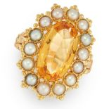 AN ANTIQUE IMPERIAL TOPAZ AND PEARL RING in high carat yellow gold, set with an oval cut imperial