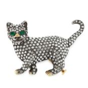 A DIAMOND AND EMERALD CAT BROOCH in yellow gold and silver, designed as a prowling cat, jewelled all