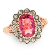 A PINK TOURMALINE AND DIAMOND DRESS RING in yellow gold and silver, set with a cushion shaped