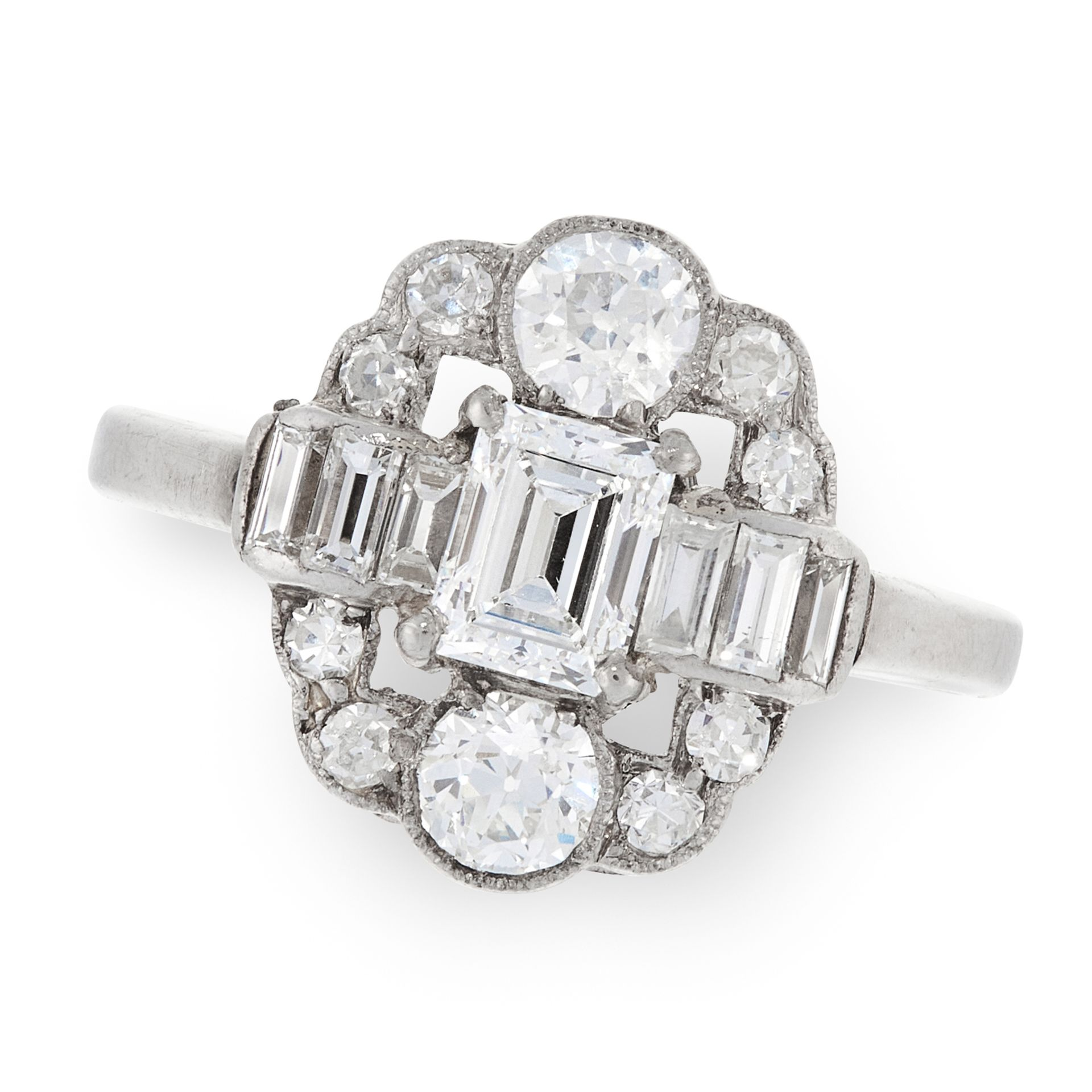 A DIAMOND DRESS RING in platinum, set with a central emerald cut diamond of 0.52 carats, flanked
