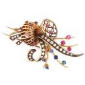 A VINTAGE RUBY, SAPPHIRE AND DIAMOND BASKET BROOCH in yellow gold and silver, designed as a spray of