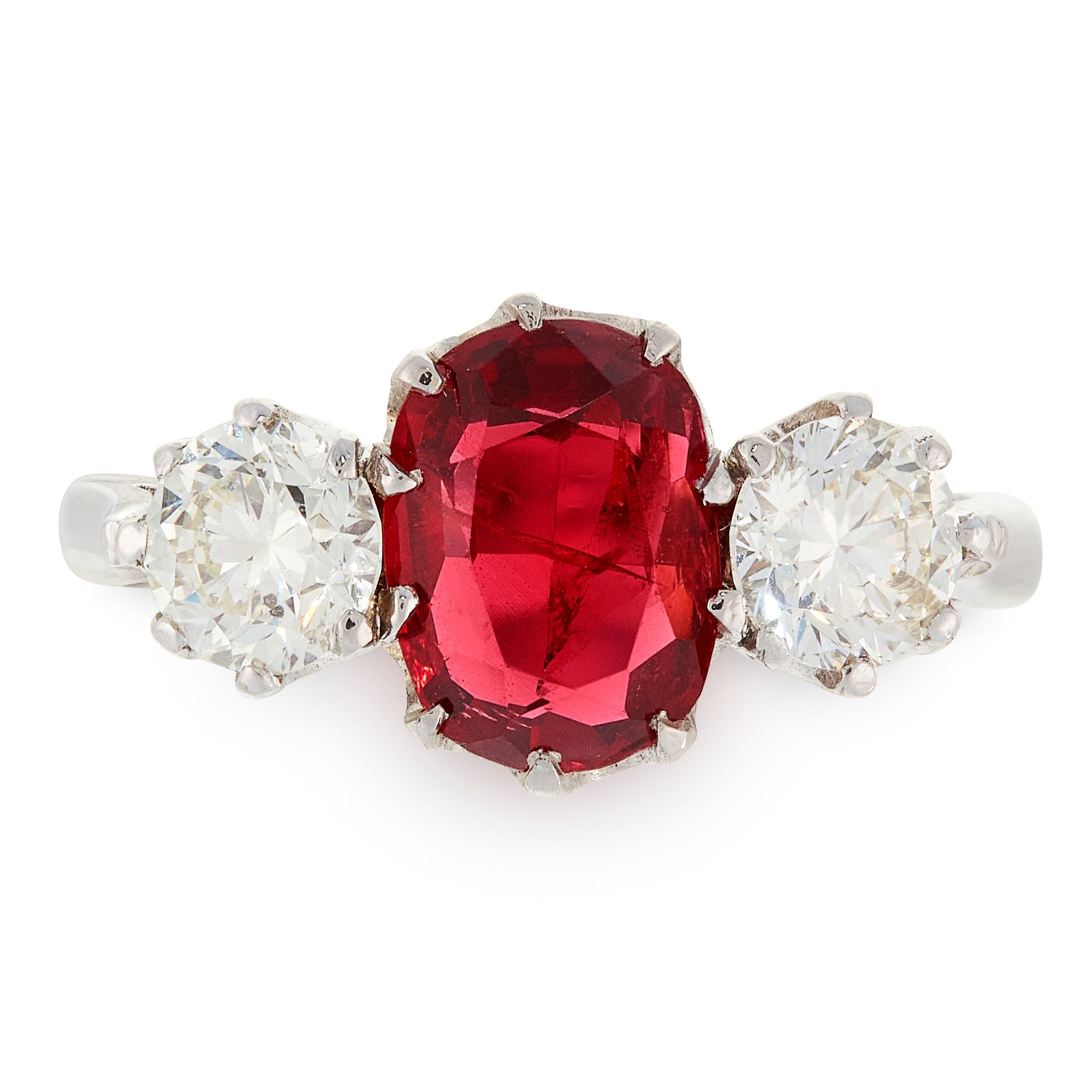 A SPINEL AND DIAMOND THREE STONE RING in platinum, set with an oval cushion cut spinel of 1.84