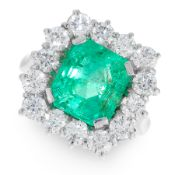 A COLOMBIAN EMERALD AND DIAMOND RING in platinum, set with a central emerald cut emerald of 6.16