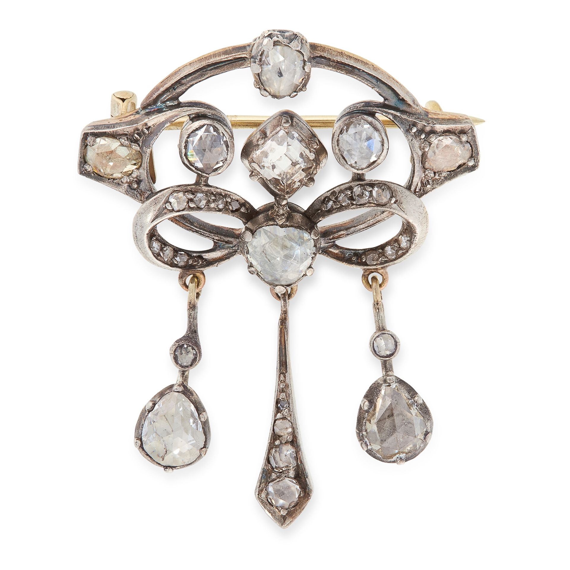 AN ANTIQUE DIAMOND BROOCH, CIRCA 1900 in yellow gold and silver, the scrolling body with central bow