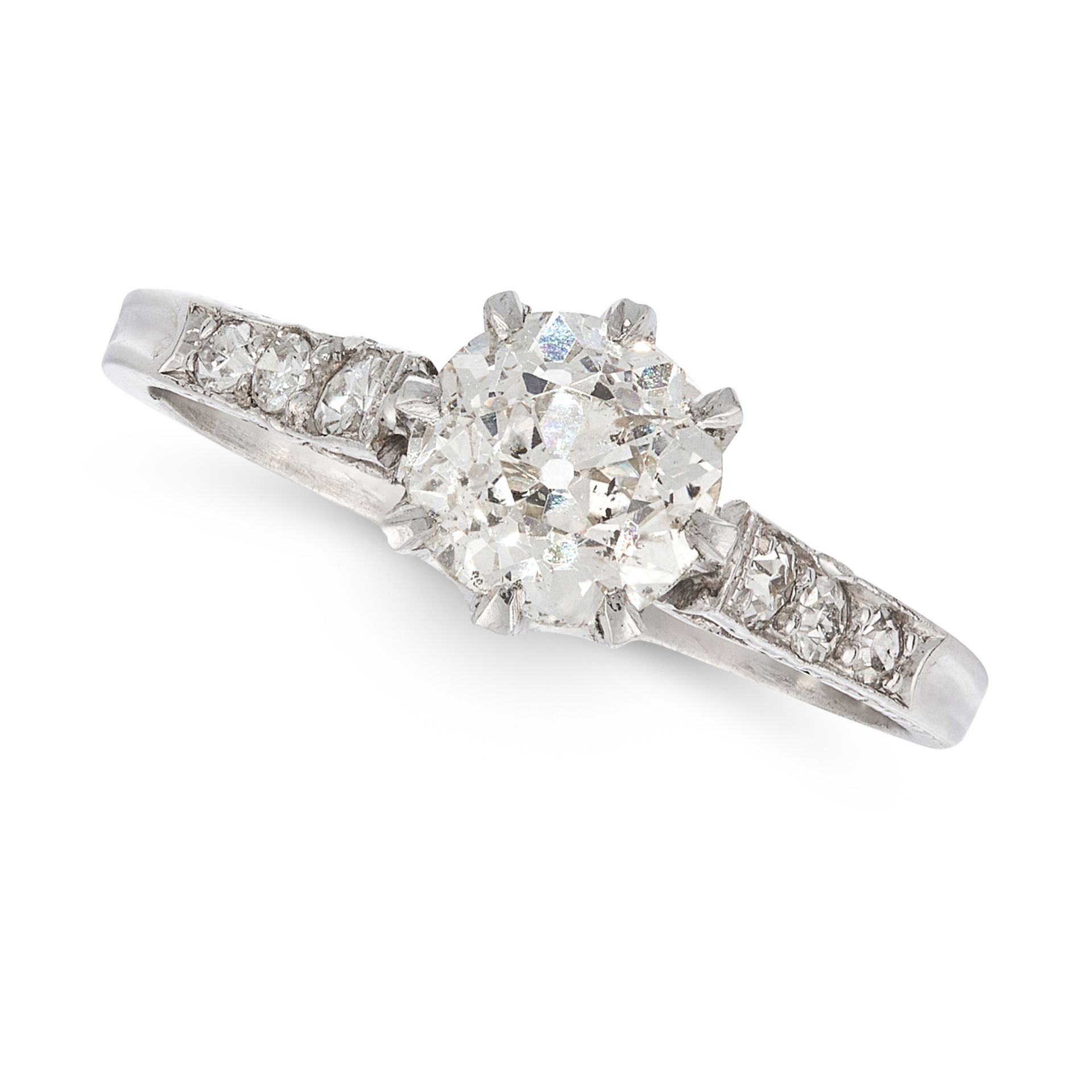A DIAMOND SOLITAIRE RING in platinum, set with a central old cut diamond of 1.08 carats, accented by