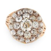 AN ANTIQUE DIAMOND CLUSTER RING, 19TH CENTURY in yellow gold and silver, the circular face set