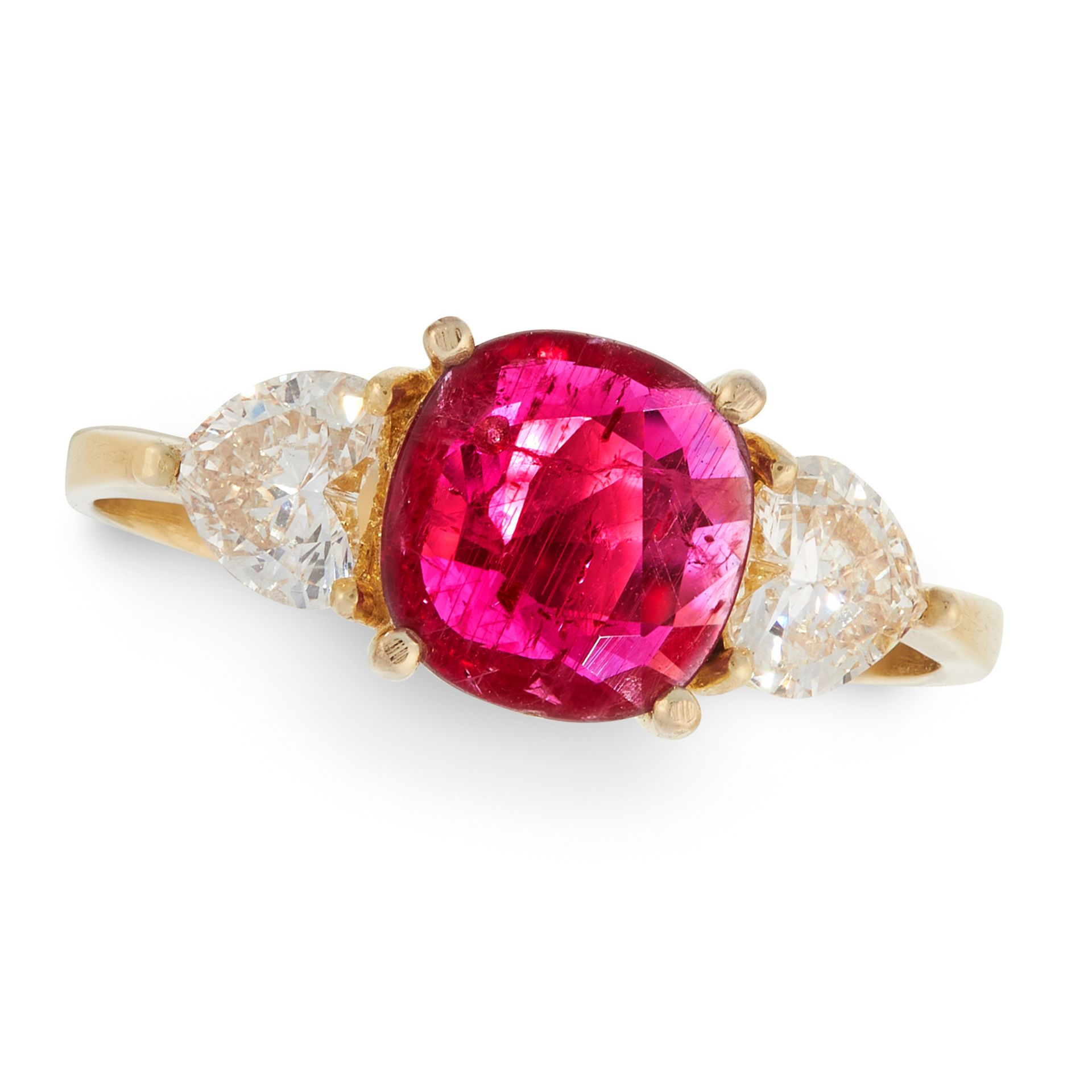 A RUBY AND DIAMOND RING in 18ct yellow gold, set with a cushion cut ruby of 1.30 carats between