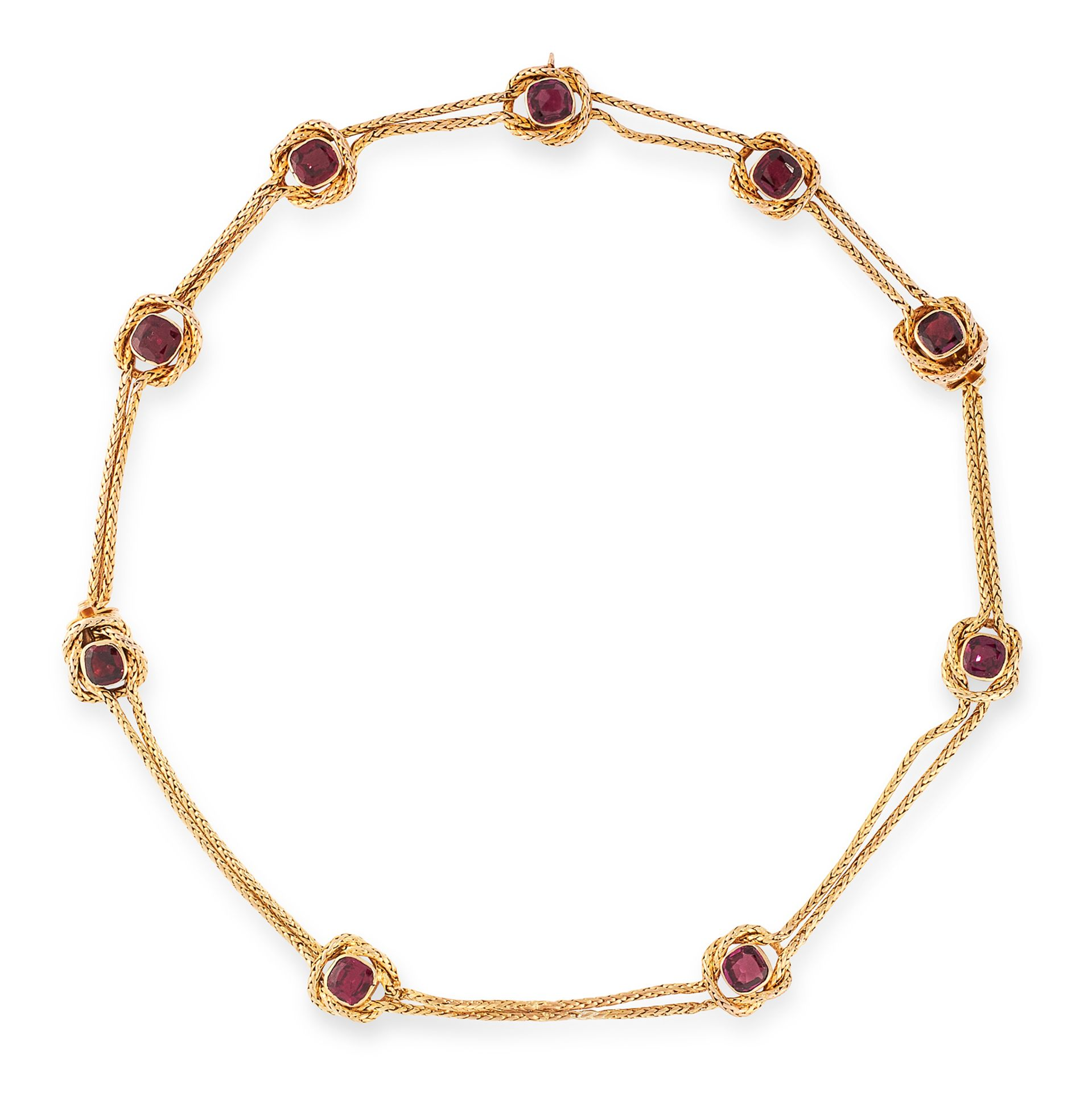 AN ANTIQUE GARNET NECKLACE in yellow gold, comprising a row of nine cushion cut garnets within