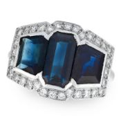 AN ART DECO SAPPHIRE AND DIAMOND DRESS RING in platinum, set with three step cut sapphires within