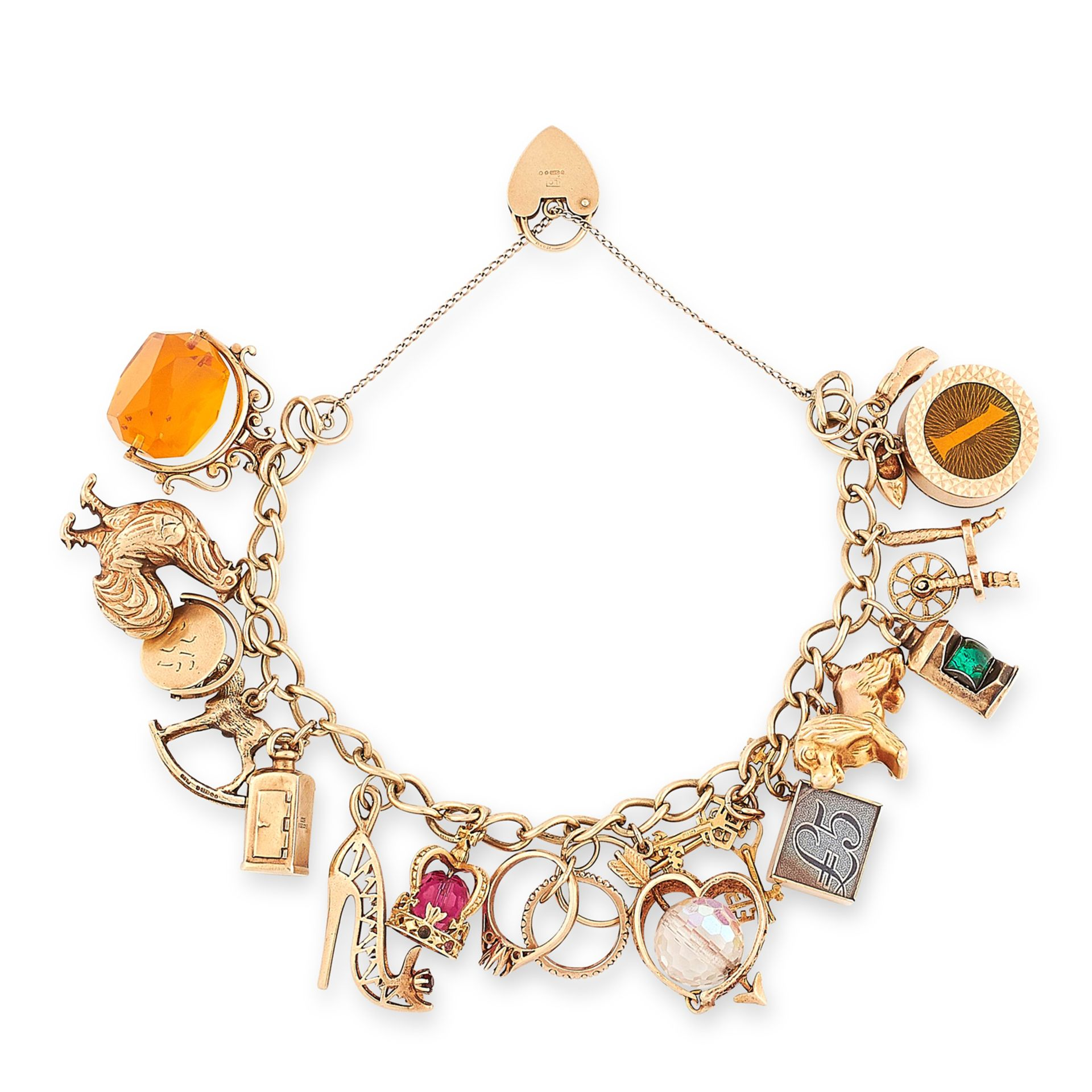 A VINTAGE CHARM BRACELET in yellow gold, suspending fifteen charms including a dog, cockerel, shoes,