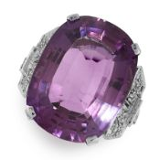 AN AMETHYST AND DIAMOND DRESS RING in 18ct white gold, set with a cushion cut amethyst of 16.59