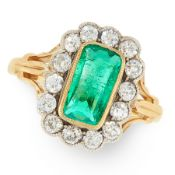 A COLOMBIAN EMERALD AND DIAMOND CLUSTER RING in 18ct yellow gold and silver, set with a mixed cut