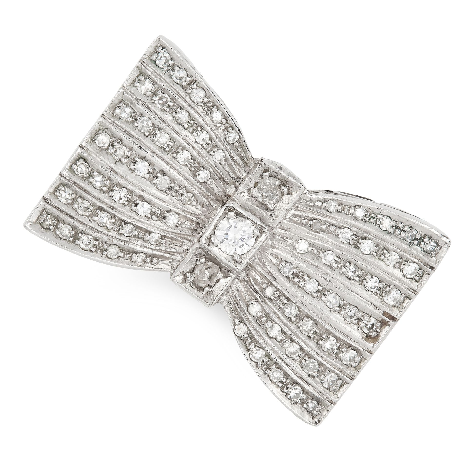 A DIAMOND BOW RING, CIRCA 1950 in white gold, designed as a bow, set with round and single cut
