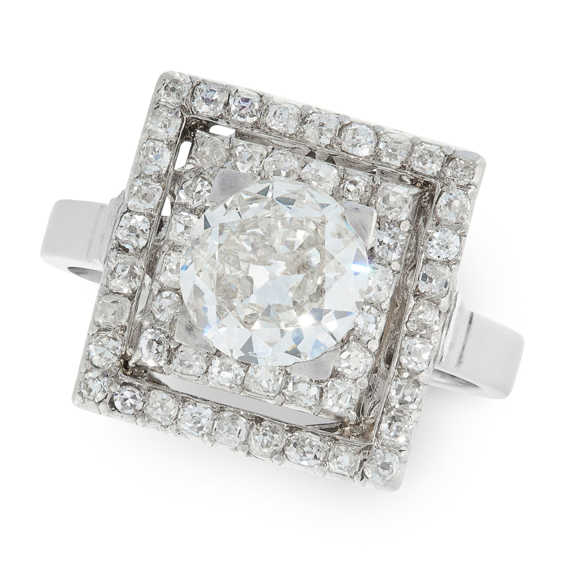 A DIAMOND DRESS RING set with a principal old cut diamond of 1.40 carats within two square