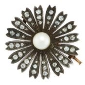 AN ANTIQUE PEARL AND DIAMOND FLOWER BROOCH in yellow gold and silver, designed as a flower, set at