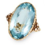 AN AQUAMARINE DRESS RING in yellow gold, set with an oval cut aquamarine of 8.99 carats in a