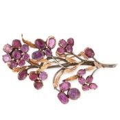 A VINTAGE GARNET FLOWER SPRAY BROOCH in 18ct yellow gold and silver, designed as a spray of flowers,