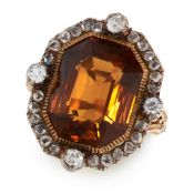 AN ANTIQUE TOURMALINE AND DIAMOND RING in yellow gold and silver, set with a mixed octagonal cut
