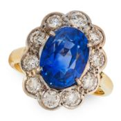A CEYLON NO HEAT SAPPHIRE AND DIAMOND RING in 18ct yellow gold, set with an oval cut blue sapphire