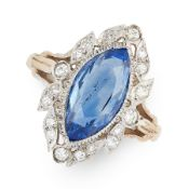 A CEYLON NO HEAT SAPPHIRE AND DIAMOND RING in white gold, set with a central marquise cut blue