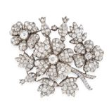 AN ANTIQUE DIAMOND EN TREMBLANT BROOCH, 19TH CENTURY in yellow gold and silver, designed as a wreath