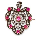AN ANTIQUE RUBY AND DIAMOND SWEETHEART PENDANT / BROOCH in yellow gold and silver, designed as a