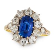A BURMA NO HEAT SAPPHIRE AND DIAMOND RING, CIRCA 1950 in 18ct yellow gold, set with a cushion cut