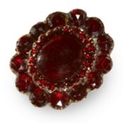 AN ANTIQUE GARNET CLUSTER RING in yellow gold and silver, set with a central cabochon garnet in a