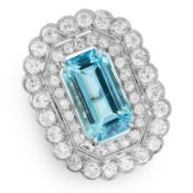 AN AQUAMARINE AND DIAMOND DRESS RING set with an emerald cut aquamarine of 8.26 carats within a