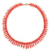 A CARVED CORAL COLLAR NECKLACE comprising of a single row of alternating coral beads and elongated