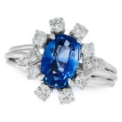 A CEYLON NO HEAT SAPPHIRE AND DIAMOND RING in 18ct white gold, set with a cushion cut sapphire of