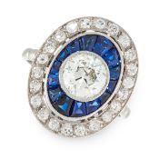 A DIAMOND AND SAPPHIRE DRESS RING in platinum, of target design, set with a central old European cut