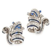 A PAIR OF RETRO SAPPHIRE AND DIAMOND EARRINGS, CIRCA 1950 in 18ct white gold, of scrolling design,